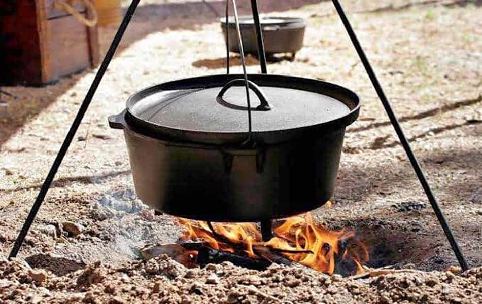 types of dutch ovens cast iron dutch oven on tripod over camp fire