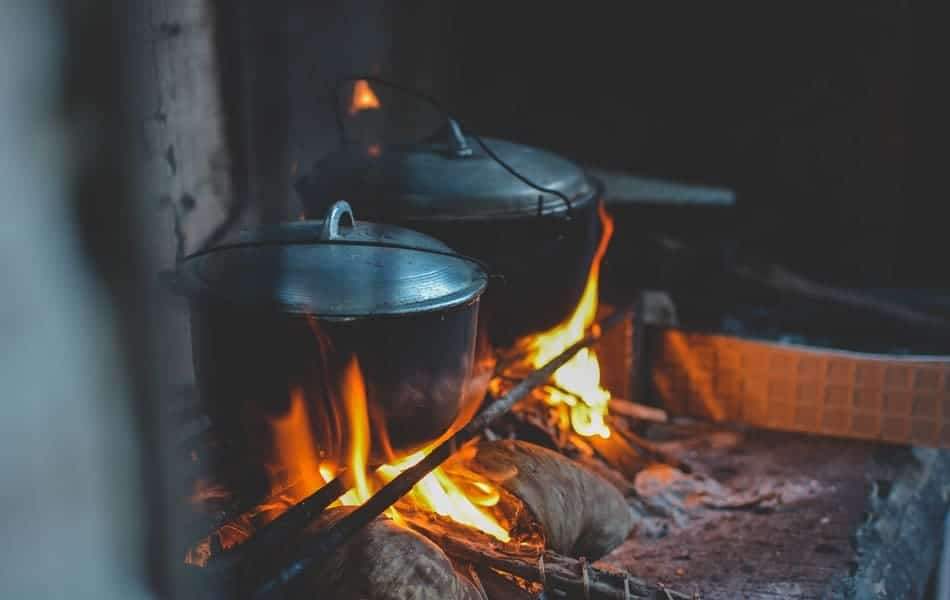 what is a Dutch oven trivet Dutch ovens sitting up over campfire